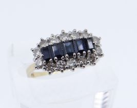 18CT GOLD SAPPHIRE & DIAMOND CLUSTER RING, the five central sapphires surrounded by fourteen