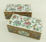 PAIR CHINESE CANTON FAMILLE ROSE DESK BOXES, 19th Century, rectangular tops decorated with long-