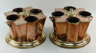 PAIR COPPER & BRASS WINE COOLERS, each with four bottle sleeves around a central lidded ice