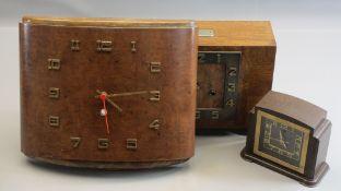 ART DECO CLOCKS - an excellent crossbanded mantel clock on bracket feet, bearing plaque 'Presented
