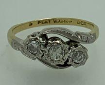 18CT GOLD & PLATINUM 3 STONE DIAMOND CROSSOVER RING, size M I-J, 3.2grms