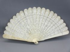 19TH CENTURY CARVED IVORY CHINESE CANTON BRISE FAN, the guard sticks decorated with people within
