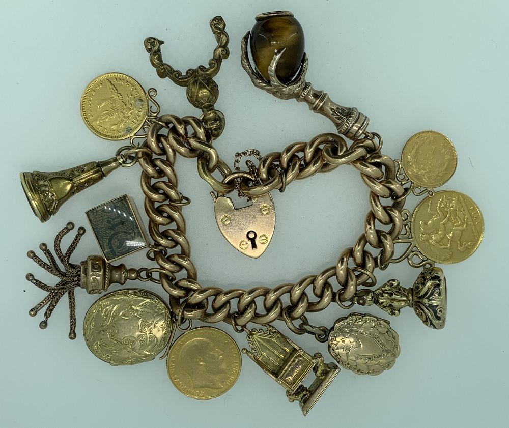 9CT GOLD CHARM BRACELET WITH 15CT GOLD PADLOCK CLASP & 13 CHARMS including a folded up one pound - Image 2 of 2