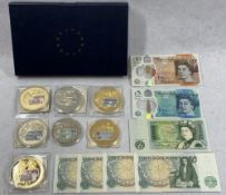 BRITISH BANK NOTE COMMEMORATIVE COINS with a quantity of banknotes, seven coins with denominations
