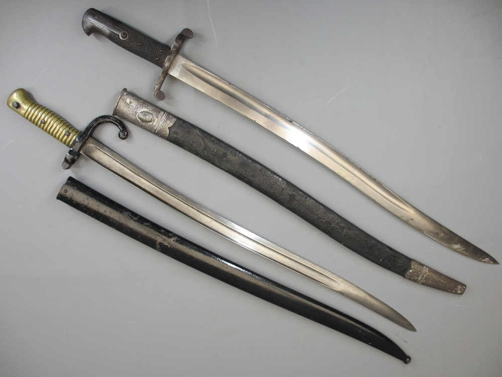 SWORD BAYONETS (2) to include a French M1866 Chassepot with metal scabbard, 22.5in blade L, 71cms