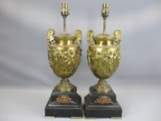 GILDED BRONZE URN TABLE LAMPS, A PAIR, on polished slate bases