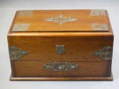 ANTIQUE OAK DESK CABINET with plated embossed detail, 17cms tall, 30 x 18cms
