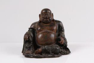 Buddha. China, 19. Jh. Bronze. Sitzende Figur. H: 22 x 24,5 cm. Rückseitig Ausbrüche.