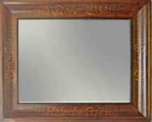 A 19th century Fernandino mahogany mirror with a carved pine inside
