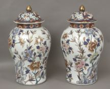A pair of 20th century Chinese vases and covers in Imari porcelain