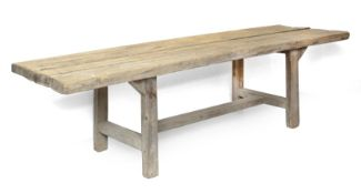 A rustic style pine dining table made with old boards