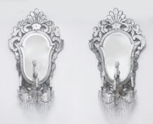 A pair of 19th century Venetian mirrors with four lights