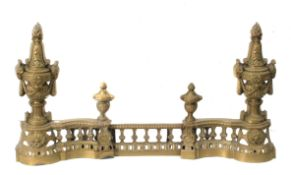 A 19th century French set of bronze fireplace front and andirons