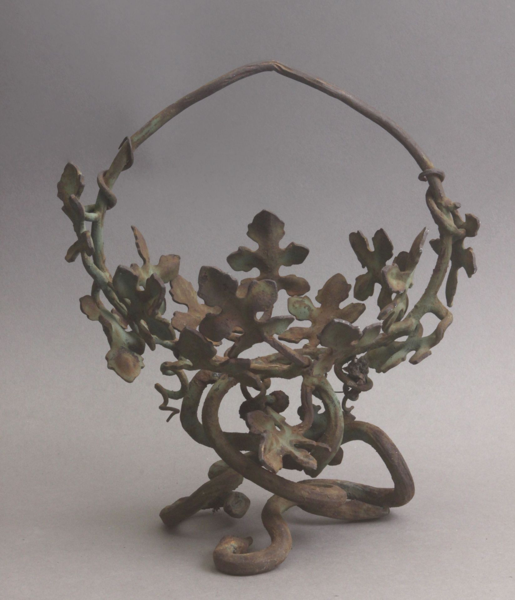 An Art Nouveau wrought iron jardiniere in the style of Manuel Ballarin in 1900