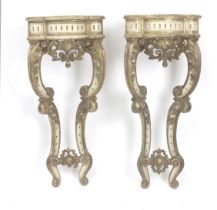 A pair of 20th century Louis XV style corbels