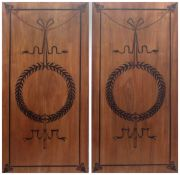 A pair of 20th century Empire style wall plaques