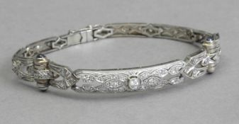 An Art-Déco bracelet circa 1920. Diamonds, sapphires, gold and platinum