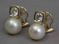 A pair of diamond and pearl 'toi et moi' earrings