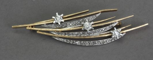 A diamond brooch with a gold setting