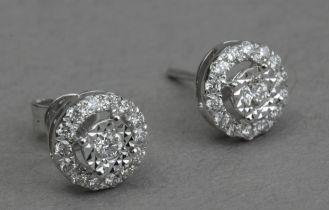 A pair of diamond stud earrings