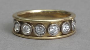 A first half 20th century diamond half eternity ring