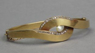 A mid 20th century diamond and pearl bracelet