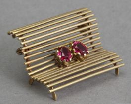 A mid 20th century gold and rubies brooch