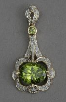A diamond and diopside pendant in an 18k. yellow gold setting
