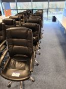 Ten Black leather swivel armchairs (Located at Q2