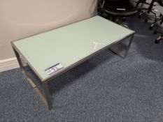 Glass top, chrome framed coffee table (Located at