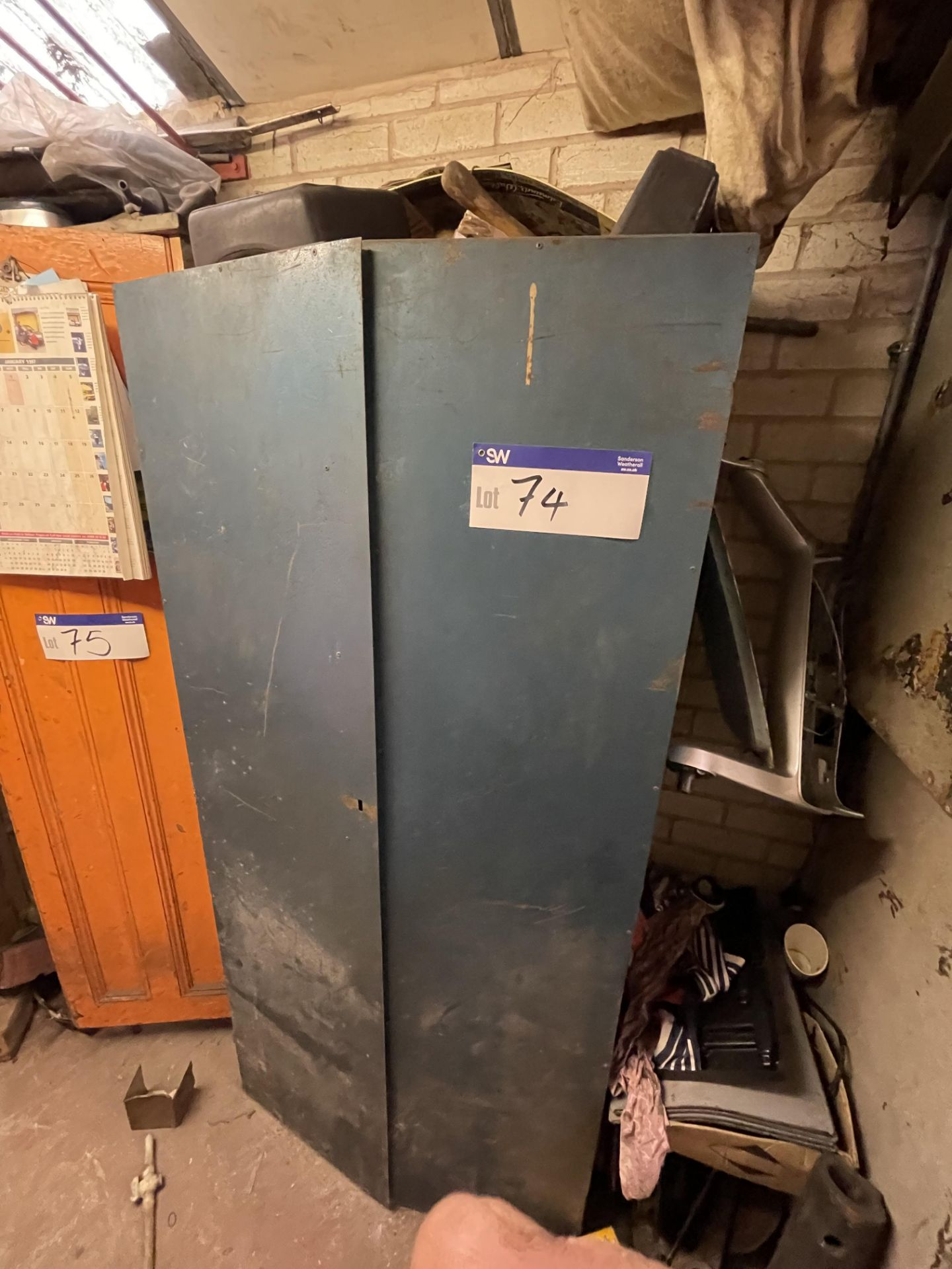Double Door Steel Cabinet, with contents(this lot is subject to 15% buyer's premium)Please read the