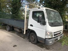Mitsubishi Fuso Canter Dropside Wagon, registration no. YJ06 DYN, date first registered 27/03/
