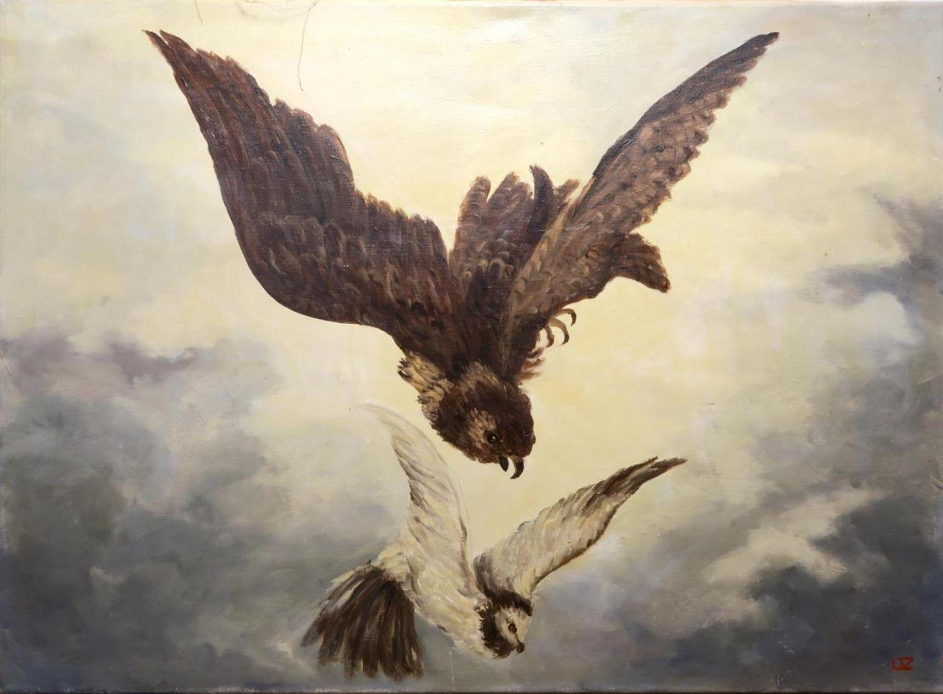 Falke auf eine Taube stoßend
