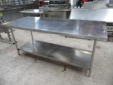 1 Mesa de acero inoxidable con entrepaño, 215 cm de largo, 90 cm de ancho y 90 cm de alto. (1