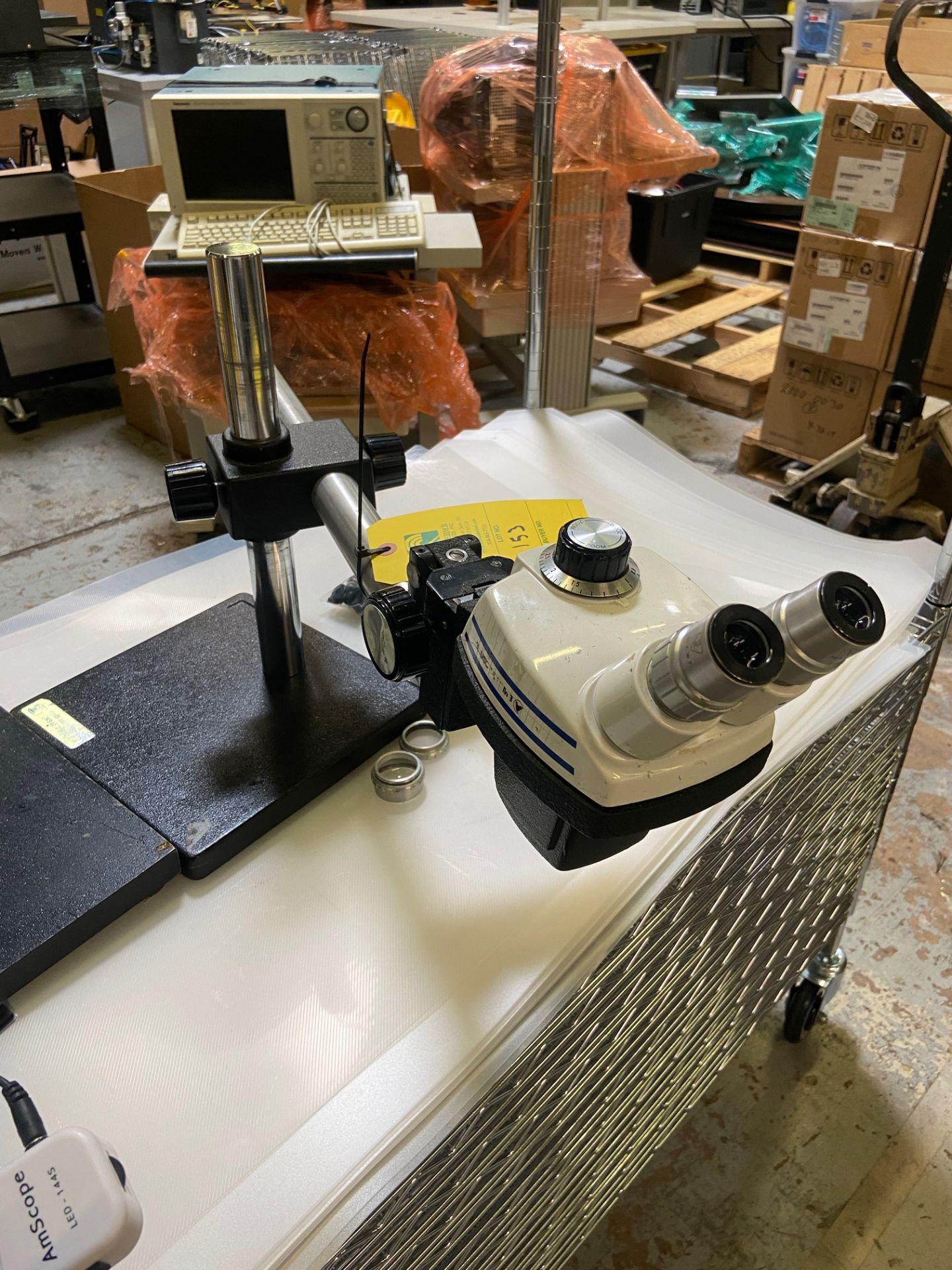 Microscope StereoZoom 4, 0.7X - 30X, Rigging Fee: $20