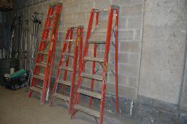 Lot of Ladders 1 - 6 foot step 1 - 7 foot platform 1 - 8 foot step ladder 1 - 12 foot step
