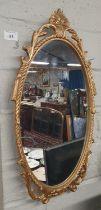 A Metal framed Mirror. 26 x 50 cm approx.
