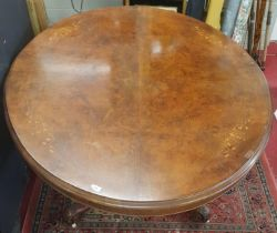 A fantastic Victorian Walnut Inlaid oval Supper Table with splayed carved pod. c1860. 145 x 117