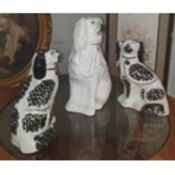 A pair of 19th Century Staffordshire Dogs along with another larger example.