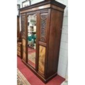 A late 19th Century Walnut three door Wardrobe along with its Dressing Table partner.