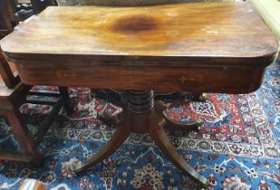 Of Superb quality a Regency Mahogany and inlaid fold over Card Table on turned quatrefoil base and