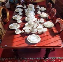 A good mid Victorian Mahogany two leaf Dining Table with turned and fluted supports. W 122 x 230 x H