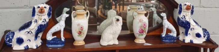 A good quantity of 19th Century and later Staffordshire Dogs and Vases.