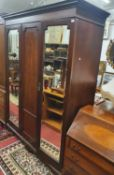 An Edwardian Mahogany and inlaid Wardrobe with twin mirrored doors. W 163 x D 56 x H 210 cm approx.