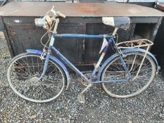 Three Vintage Bicycles to include Raleigh.