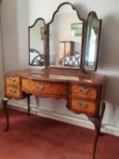 A 20th Century Walnut Dressing Table with triptych mirrored back on carved cabriole supports. H158 x