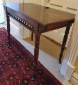 A Arts and Crafts Walnut Side Table.