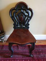 A good pair of early 19th Century Mahogany Hall Chairs with highly pierced backs and heavy solid