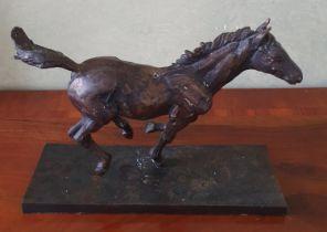 A Bronze Sculpture of a Racehorse. Signed Arnup. H23 x D10 X W33cm approx.