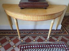 A pair of half moon Side Tables painted in the Regency style. On turned supports. W154 x H81 x
